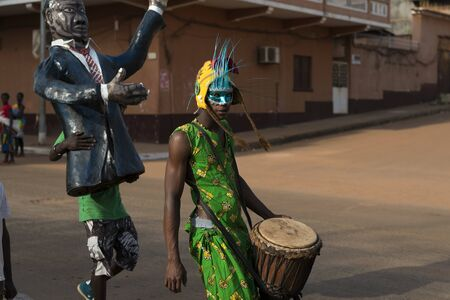 Bissau, Republic of Guinea-Bissau - February 12, 2018: Musician wearing a costume during the Carnival celebrations at the Bandim neighborhood in the city of Bisssau.