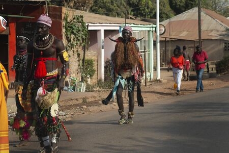 Bissau, Republic of Guinea-Bissau - February 12, 2018: Group of men wearing traditional costumes during the Carnival celebrations at the Bandim neighborhood in the city of Bisssau.