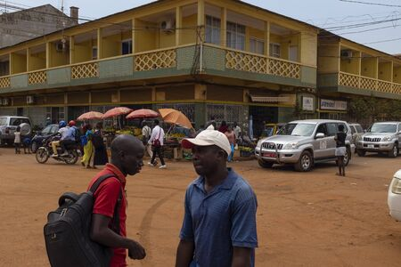 Bissau, Republic of Guinea-Bissau - February 5, 2018: Street scene in the city of Bissau with people crossing a street and vendors, in Guinea-Bissau, West Africa 에디토리얼