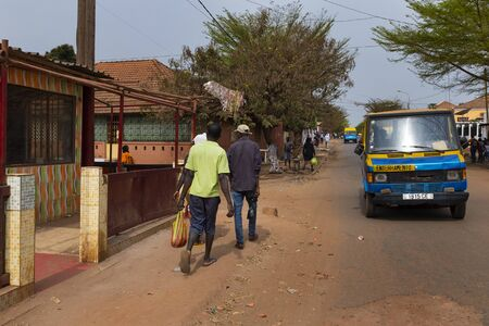 Bissau, Republic of Guinea-Bissau - February 5, 2018: Street scene in the city of Bissau with people walking along a street at the Chao de Papel neighbourhood, in Guinea-Bissau, West Africa 에디토리얼