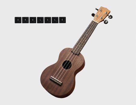 ukulele acoustic instrument vintage on isolated background Stockfoto
