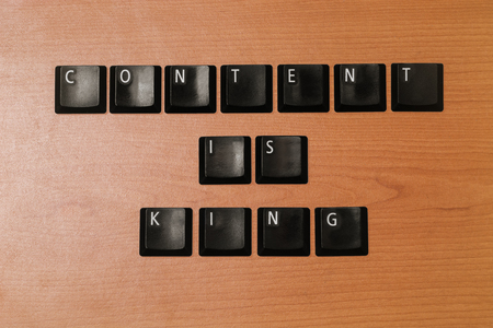 linkbuilding: content is king wooden texture on isolated background