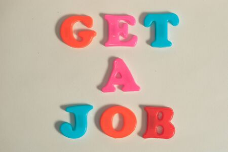 plastic letters message get a job on white isolated background