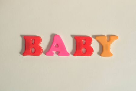plastic letters message baby on white isolated background