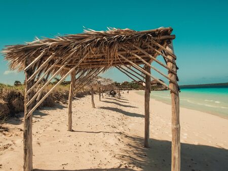 view from a beach cabana on the Caribbean, blue ocean and cloudy sky. A perfect summers day. Tropical background