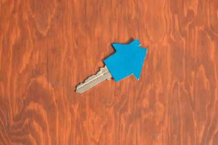 New home keys on wooden desk, real estate concept. Acquisition of a home.