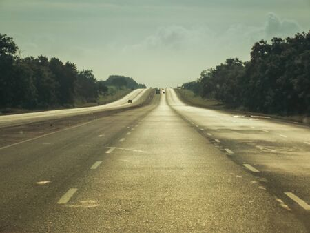 Caribbean road trip. A view south along the arterial road north of Cienfuegos in the north east of Cuba. The road is one of the most northerly A roads on the Cuban mainland. Copy Space Stock Photo
