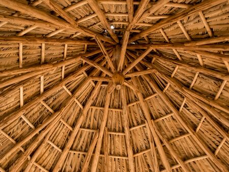 Rustic beach roof, view inside of palm umbrella used for outdoor, beautiful patterns and wood textures