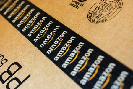 Monterrey, Mexico - Sept 3,0 2019: Amazon standard shipping box. Amazon logotype printed on cardboard box security scotch tape.