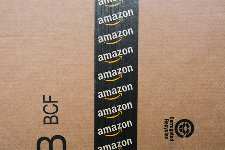 Monterrey, Mexico - Sept 3,0 2019: Amazon standard shipping box. Amazon logotype printed on cardboard box security scotch tape. Frontal view