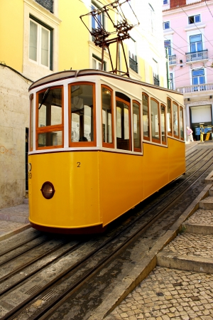 This funicular is one of the three that still work everyday in Lisbon  Stock Photo - 15419088