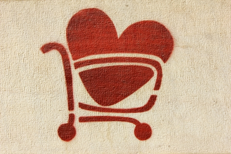 shopping buggy: Red Heart and Shopping Cart Stock Photo