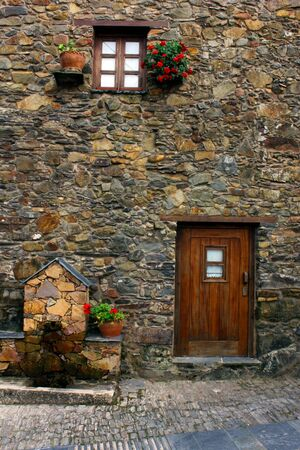 Detail of a house built in schist. photo