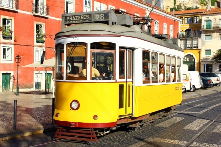 The tram 28 in the historical quarter of Alfama