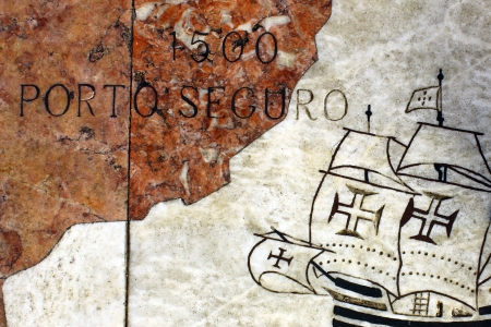 portuguese: Detail of a caravel at the wind rose in marble near the Monument to the portuguese sea discoveries at Lisbon, Portugal