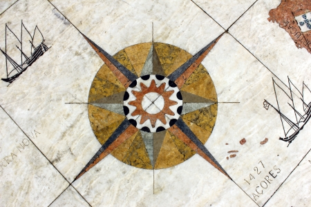 ship bow: Detail of a wind rose in marble near the Monument to the portuguese sea discoveries at Lisbon, Portugal