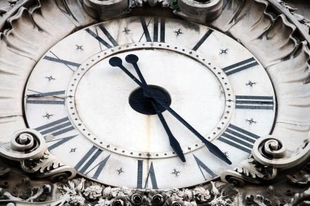 vespers: Augusta street clock, Lisbon, Portugal