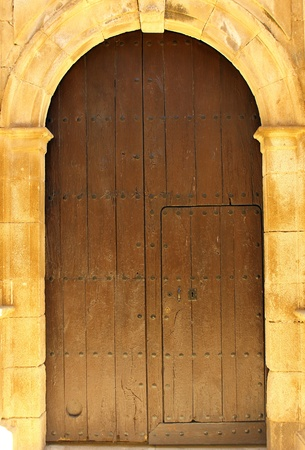 Detail of a door at Alcantara, Spain photo