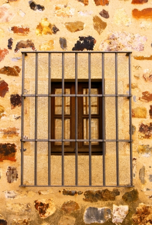 iron barred: Detail of an old window, Caceres, Spain