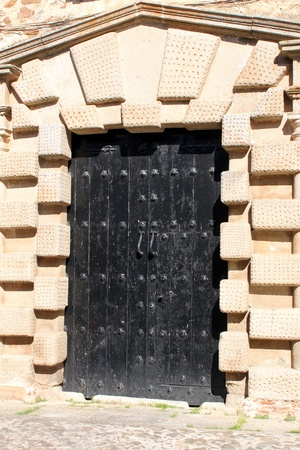 Detail of a door at Caceres, Spain photo