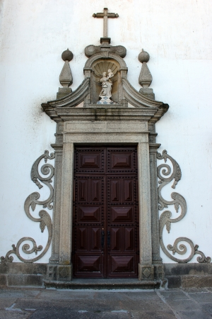entryway: Detail of a church door, Evora, Portugal
