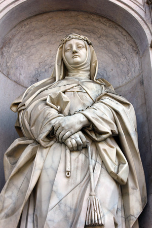 Detail of a stone statue of a saint photo