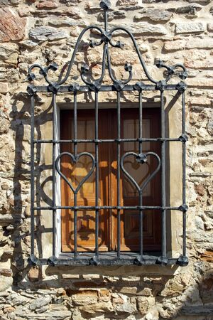 iron barred: Window, Monsaraz, Portugal Stock Photo