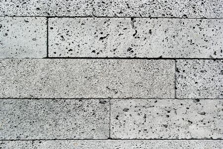 porous brick: Detail of a wall made of volcanic stone