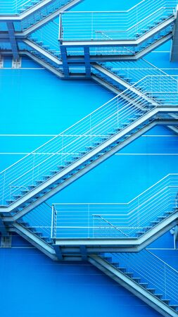 blue steel: Detail of the geometric stairs of a building located at the Nations Park in city of Lisbon, Portugal Stock Photo