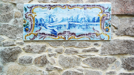 Detail of some azulejos and a stone wall Stock Photo