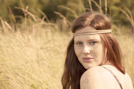 mini farm: Young redhead farmer woman Stock Photo
