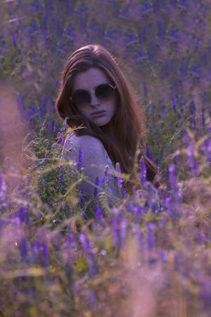 Beautiful redhead in a lavender field Stock Photo