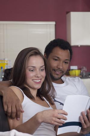interracial: Interracial couple reading together