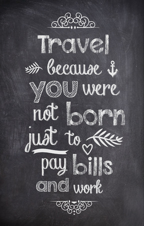 Travel Quote written with chalk on a black board