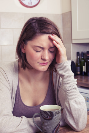 emotional grief: Young woman suffering from headache Stock Photo