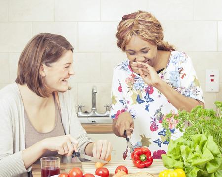 Happy friends cooking in kitchen Stock fotó - 48283099