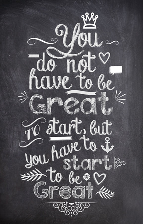 Motivation Quote written with chalk on a black board