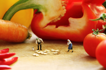 midget: Tiny dolls cooking vegetables