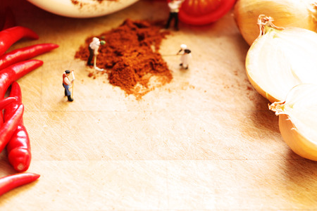 midget: Tiny dolls cooking vegetables, with space for your text