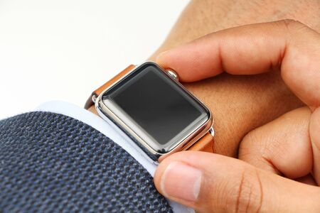 Business mans hand with a smart watch and app with space for your logo