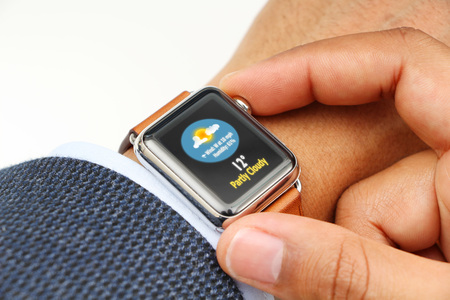 Business man checking weather with a smart watch app