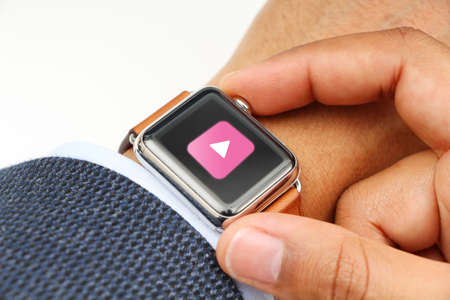 mans watch: Business mans hand with a smart watch and music app