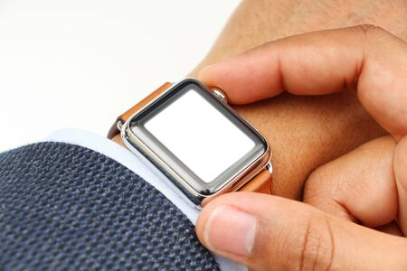 suited up: Business mans hand with a smart watch and blank space