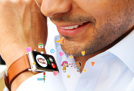 smart man: Man making a call with a smart watch
