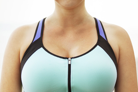 Woman's chest in her sports bra