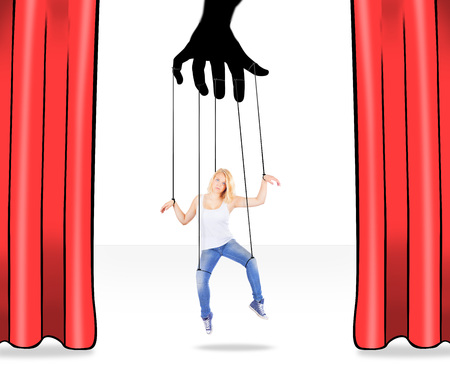 submissive: Girl being held by strings as a puppet Stock Photo