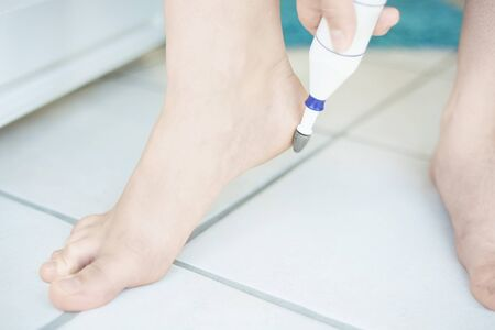 footcare: Electric foot scrubber being used in pedicure