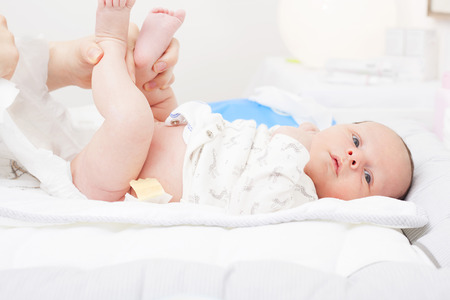 Changing the diaper of a newborn