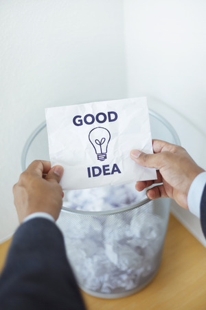 finds: Boss finds employees good idea in garbage can. Business concept