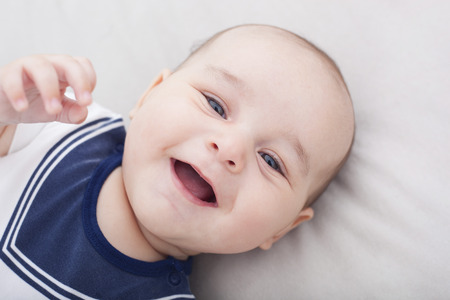 Portrait of cute cheerful baby